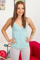 Pretty Liza Rowe posing in a turquoise chemise.
