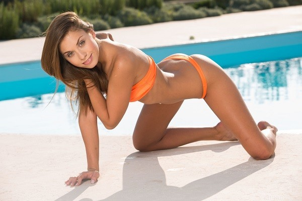 Solo porn star Sabrisse on her knees by the pool
