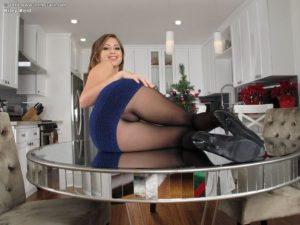 Riley Reid pulls up her skirt in pantyhose fore InTheCrack.