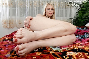 Gorgeous Lily Rader shows her feet.