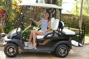 Glamour nude model Linda Chase barefoot in her golf cart.