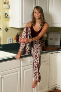 Gorgeous pornstar Liza Rowe sitting on the sink.