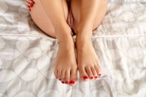 Feet with painted toenails.