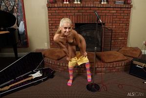 Uma Jolie in socks playing guitar and gyn tools.