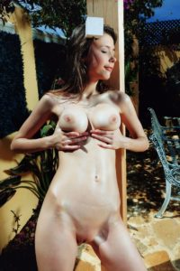 Mila Azul showing her boobs.