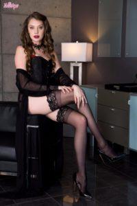 Pornstar Elena Koshka in stockings and high heels.