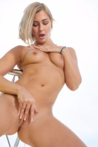 Tracy Lindsay touching pussy.
